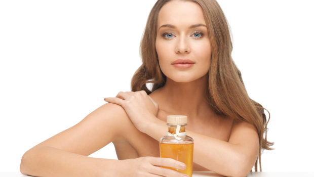 picture-of-beautiful-woman-with-oil-bottle-128006885.jpg